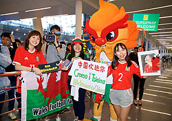 NANNING, CHINA - Monday, March 19, 2018: Wales supporters greet the team as they arrive at Nanning International Airport for the 2018 Gree China Cup International Football Championship. (Pic by David Rawcliffe/Propaganda)