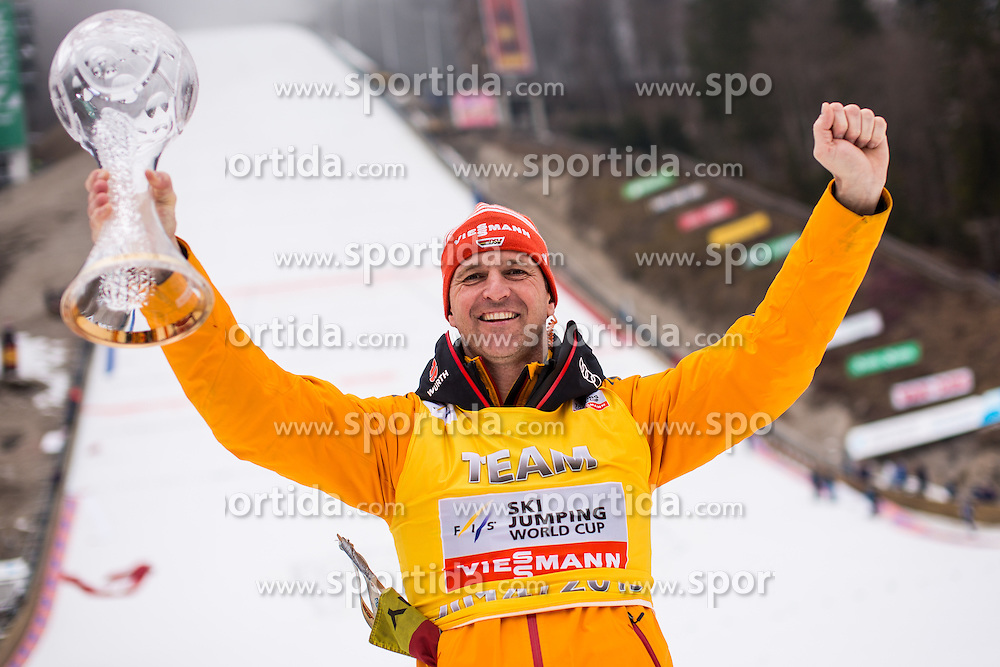Werner Schuster head coach of team Germany celebrate with overall team cup globe after the Ski Flying Individual Competition at Day 4 of FIS World Cup Ski Jumping Final, on March 22, 2015 in Planica, Slovenia. . Photo by Grega Valancic / Sportida