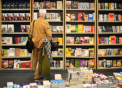 © Licensed to London News Pictures. 03/10/2012. Manchester, UK A man looks at a book stall selling political books on Day 5 at The Labour Party Conference at Manchester Central today 3rd october 2012. Photo credit : Stephen Simpson/LNP
