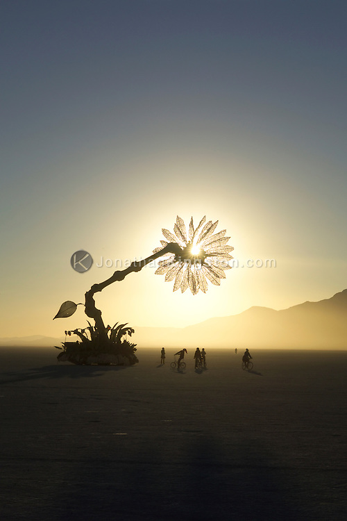 "BLACK ROCK CITY, NV - SEPTEMBER 5:  The sun rises behind the mobile art work titled ""Miracle Grow"" by Patrick Shearn, Abundant Sugar and the DoLab of Los Angeles in Black Rock City, Nevada on September 5, 2005.  The city is home to Burning Man, an annual one-week event dedicated to radical self-reliance, radical self-expression and art.  Artists from around the country bring innovative sculptures such as ""Miracle Grow"" to the city. (Photo by, Jonathan Kingston/Aurora)"