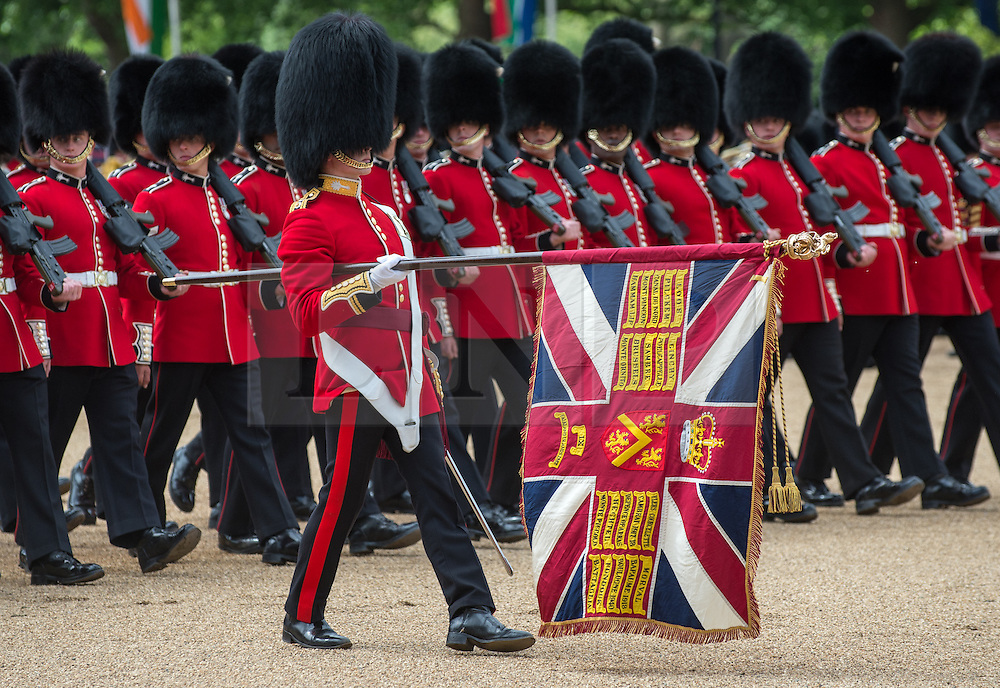 """© London News Pictures. 30/05/2015. London, UK. The Queen's Colour is """"Trooped"""". This year the honour falls to the Welsh Guards in recognition of 2015 as the 100th anniversary of their founding.  The Major General's Review on Horse Guards Parade, London. 5,500 spectators filled the stands to witness the first of three annual world class military demonstrations that culminate with the Queen's Birthday Parade on 13th June. Photo credit: Sergeant Rupert Frere/LNP"""
