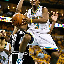 03 May 2008: New Orleans Hornets guard Chris Paul #3 looks to pass as Bruce Bowen #12 defends from behind in the first half of the NBA Playoff Semi-Finals Game 1 matchup between the San Antonio Spurs and the New Orleans Hornets at the New Orleans Arena in New Orleans, LA.