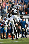 Jacksonville Jaguars rookie defensive back Ronnie Harrison (36) leaps and celebrates after a game winning defensive stand during the NFL week 13 regular season football game against the Indianapolis Colts on Sunday, Dec. 2, 2018 in Jacksonville, Fla. The Jaguars won the game in a 6-0 shutout. (©Paul Anthony Spinelli)