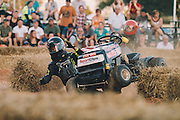 July 31, 2015 and Aug 1, 2015; Clements, MD, USA; Reportage from the STA-BIL National Lawn Mower Racing Series at Bowles Farm in Clements, MD. Racers posed for portraits, before and during practice heats. Racers competed in at least 10 different mower classes on a 700 ft long dirt track. The course is surrounded by cornfields. <br /> <br /> Mandatory Credit: Brian Schneider-www.ebrianschneider.com<br /> Instagram - @ebrianschneider<br /> Twitter - @brian_schneider<br /> Facebook - Facebook.com/ebrianschneider or Facebook.com/brianschneiderphotography