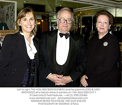 Left to right, THE HON.MRS MONTGOMERY and her parents LORD & LADY BIRDWOOD at a fashion show in London on 15th April 2002.	OYY 1