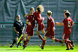 NEWPORT, WALES - Thursday, September 25, 2014: Wales' Daniel Jefferies celebrates scoring the winning second goal against France during the Under-16's International Friendly match at Dragon Park. (Pic by David Rawcliffe/Propaganda)