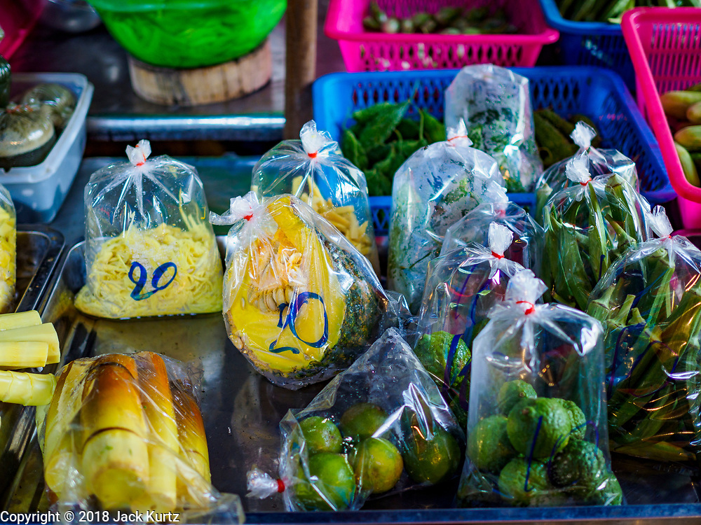 20 JUNE 2018 - BANGKOK, THAILAND: Produce in plastic bags at Makkasan Market, a small local market in central Bangkok. Officials in Thailand are wrestling with Thais use of plastic bags. The issue became a public one in early June when a whale in Thai waters died after ingesting 18 pounds of plastic. In a recent report, Ocean Conservancy claimed that Thailand, China, Indonesia, the Philippines, and Vietnam were responsible for as much as 60 percent of the plastic waste in the world's oceans.     PHOTO BY JACK KURTZ