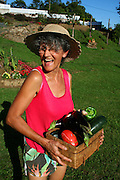 woman laughing with veggie basket