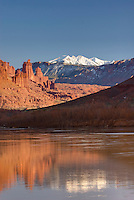 Fisher Towers and the snowcapped La Sal Mountains with the Colorado River in the foreground, near Moab Utah