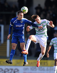Oldham Athletic's Liam Kelly challenges for the high ball with Yeovil Town's Sam Foley - Photo mandatory by-line: Harry Trump/JMP - Mobile: 07966 386802 - 07/03/15 - SPORT - Football - Sky Bet League One - Yeovil Town v Oldham Athletic - Huish Park, Yeovil, England.