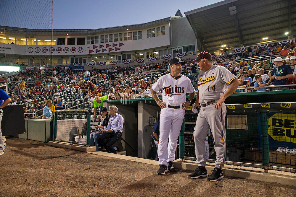 FORT MYERS, FL- MARCH 04: Paul Molitor #4 of the Minnesota Twins talks with University of Minnesota Golden Gophers manager John Anderson #14 on March 4, 2015 at the CenturyLink Sports Complex in Fort Myers, Florida. (Photo by Brace Hemmelgarn) *** Local Caption *** Paul Molitor;John Anderson