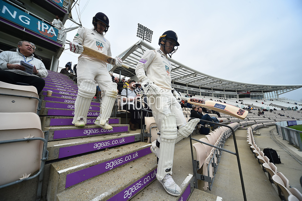 Jimmy Adams of Hampshire (front) and Lewis McManus of Hampshire walk down the steps to open the batting on the first day of play in the new County Championship season during the Specsavers County Champ Div 1 match between Hampshire County Cricket Club and Worcestershire County Cricket Club at the Ageas Bowl, Southampton, United Kingdom on 13 April 2018. Picture by Graham Hunt.