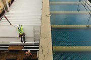 Workers installing filtration panels In a water plant near Atlanta Georgia