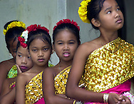 Young members of the Cambodian Association of Greater Philadelphia, await their turn to perfom a Cambodian dance, at the opening event for the 2001 Dragon Boat Racing Championships, Monday, July 30, 2001,  in Philadelphia, Pa. The event runs through Aug. 5th. (Photo by William Thomas Cain/PhotoDX.com)