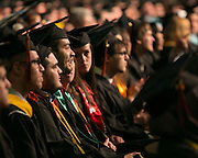 Graduates share a laugh at RIT's Convocation Ceremony in Rochester on Friday, May 22, 2015.