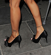 28.JUNE.2012. LONDON<br /> <br /> KATIE PRICE LEAVING NOBU RESTAURANT, BERKLEY SQUARE SHOWING OFF A TATTOO WITH ON HER LEG OF THE NAME LEO PLUS A DATE UNDERNEATH THE NAME.<br /> <br /> BYLINE: EDBIMAGEARCHIVE.CO.UK<br /> <br /> *THIS IMAGE IS STRICTLY FOR UK NEWSPAPERS AND MAGAZINES ONLY*<br /> *FOR WORLD WIDE SALES AND WEB USE PLEASE CONTACT EDBIMAGEARCHIVE - 0208 954 5968*