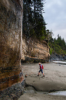 Mystic Beach on the Juan de Fuca Trail on the West Coast of Vancouver Island features steep rock walls, a wide sandy beach and a seasonal waterfall.