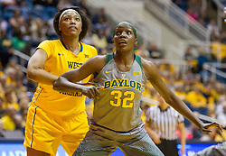 Jan 30, 2016; Morgantown, WV, USA; Baylor Bears forward Beatrice Mompremier (32) boxes out West Virginia Mountaineers center Lanay Montgomery (15) during the third quarter at WVU Coliseum. Mandatory Credit: Ben Queen-USA TODAY Sports