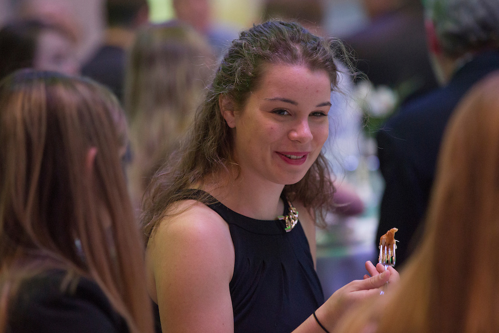 Nicole Sova, a senior in the Russ Colloge of Engineering and a Gerald Loehr Outstanding Senior Leader Nominee for chemical and biomolecular engineering, eats lunch and talks to her family and peers at the beginning of the Fritz J. and Dolores H. Russ College of Engineering and Technology Student Awards Banquet, hosted by Tau Beta Pi, the engineering honor society at Ohio University, on April 10, 2016. (Photo by Emily Matthews