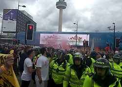 Police officers attend a planned English Defence League demonstration at Lime Street Station in Liverpool, which also attracted a counter demonstration from anti-fascist protesters.