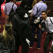 November 11, 2014, Las Vegas, Nevada:<br /> Billie Weiss poses with a member of the Jabbawockeez in Las Vegas, Nevada Sunday, November 9, 2014.<br /> (Photo by Billie Weiss/TEAMS)