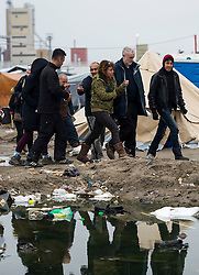 © Licensed to London News Pictures. 23/01/2016. Calais, France. Leader of the Labour Party JEREMY CORBYN (second right) visits the camp known as the 'Jungle' in Calais, France, where thousands of migrants and refugees attempting to reach the UK are currently living. Photo credit: Ben Cawthra/LNP