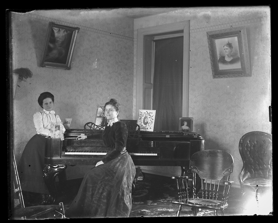 Victorian photograph of women next to a piano in their home in Fallston, Maryland.