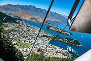 See Queenstown, Lake Wakatipu, and The Remarkables from Bob's Peak, reached via Skyline Queenstown gondola or a hiking trail. Queenstown, Otago region, South Island of New Zealand.