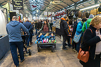 Triplets' day out with mum at St George's Market, Belfast, N Ireland, UK, 16th November 2019, 201911161767<br /><br />Copyright Image from Victor Patterson, Belfast, UK<br /><br />t: +44 28 9066 1296 (from Rep of Ireland 048 9066 1296)<br />m: +44 7802 353836<br /><br />victorpattersonbelfast@gmail.com<br />www.victorpatterson.com<br /><br />Please see my Terms and Conditions of Use at https://www.victorpatterson.com/page2<br />It is IMPORTANT that you familiarise yourself with them.<br /><br />Images used online incur an additional cost and must be visibly watermarked i.e. © Victor Patterson within the body of the image and copyright metadata must not be deleted. Images used on the Internet have a size restriction of 4kbs and are chargeable at rates available at victorpatterson.com.<br /><br />This image is only available for the use of the download recipient i.e. television station, newspaper, magazine, book publisher, etc, and must not be passed on to any third party. It is also downloaded on condition that each and every subsequent usage is notified within 7 days to victorpattersonbelfast@gmail.com<br /><br />The right of Victor Patterson to be identified as the author is asserted in accordance with The Copyright Designs And Patents Act (1988). All moral rights are asserted.