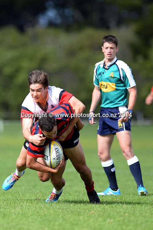 Damian Darlington tackled by Jarimar Schuster, BNZ Condor Sevens, Boy's Final - Rotorua Boys' High School v Scot's College of Wellington, Sunday 30 November 2014. Photo: Raghavan Venugopal/www.photosport.co.nz