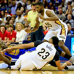 Oct 28, 2016; New Orleans, LA, USA;  Golden State Warriors forward Draymond Green (23) and New Orleans Pelicans forward Anthony Davis (23) scramble for a loose ball during the first quarter of a game at the Smoothie King Center. Mandatory Credit: Derick E. Hingle-USA TODAY Sports