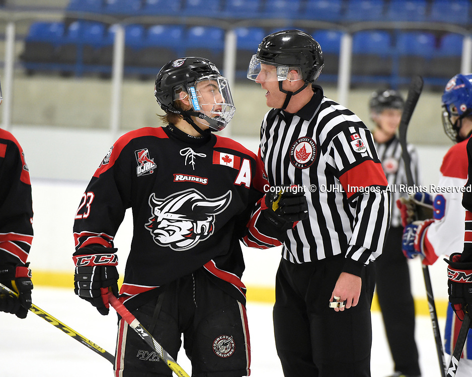 TORONTO, ON - MAR 21,  2017: Ontario Junior Hockey League, playoff game between the Toronto Jr. Canadiens and the Georgetown Raiders, OHA Referee Jonathan Wallace and Jack Jacome #23 of the Georgetown Raiders discuss the call during the second period.<br /> (Photo by Andy Corneau / OJHL Images)