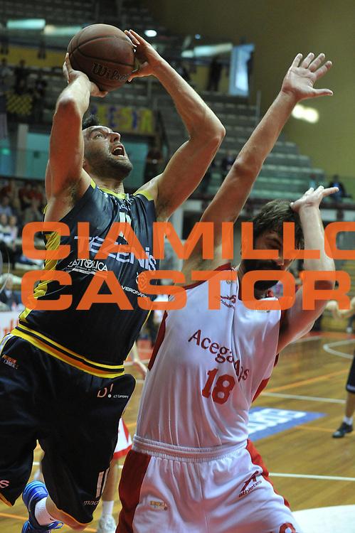 DESCRIZIONE : Trieste Campionato Lega A2 2012-2013 AcegasAps Trieste Tezenis Verona <br /> GIOCATORE : giorgio boscagin<br /> CATEGORIA :  tiro<br /> SQUADRA : AcegasAps Trieste Tezenis Verona<br /> EVENTO : Campionato Lega A2 2012-2013<br /> GARA : AcegasAps Trieste Tezenis Verona<br /> DATA : 25/04/2013<br /> SPORT : Pallacanestro <br /> AUTORE : Agenzia Ciamillo-Castoria/M.Gregolin<br /> Galleria : Lega Basket A2 2012-2013 <br /> Fotonotizia : Trieste Campionato Lega A2 2012-2013 AcegasAps Trieste Tezenis Verona<br /> Predefinita :