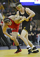 January 22 2010: Iowa's Derek St. John takes down Ohio State's Sean Nemec during the 157-pound bout an NCAA wrestling dual at Carver-Hawkeye Arena in Iowa City, Iowa on January 22, 2010. St. John defeated Nemec 9-3 and Iowa defeated Ohio State 33-3..