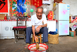 August 17, 2017 - Puyang, Puyang, China - Puyang, CHINA-15th August 2017: (EDITORIAL USE ONLY. CHINA OUT) ..Lu Xicai, a 110-year-old veteran, is busy with making traditional wheat straw handicrafts at home in Huoyuan Village, Puyang City, central China's Henan Province. Lu joined the army in 1933 and fought with Japanese soldiers during the World War II. ''Old soldiers never die, they just fade away.'' The old soldier Lu doesn't fade away. He still lives a simple but healthy life. (Credit Image: © SIPA Asia via ZUMA Wire)