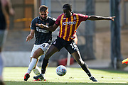 Jordan Turnbull of Northampton Town   and Bradford City's Clayton Donaldson(10) contest a loose ball  during the EFL Sky Bet League 2 match between Bradford City and Northampton Town at the Utilita Energy Stadium, Bradford, England on 7 September 2019.