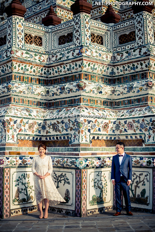 Engagement session (pre-wedding) at Wat Arun Temple in Bangkok, Thailand.<br /> <br /> <br /> Photo by NET-Photography<br /> Thailand Professional Documentary Wedding Photographer<br /> <br /> <br /> Read our blog about this Bangkok prenuptial at https://thailand-wedding-photographer.com/bangkok-engagement-session-at-wat-arun-china-town/<br /> <br /> <br /> https://thailand-wedding-photographer.com<br /> info@net-photography.com<br />   <br /> LIKE US ON FACEBOOK !<br /> https://www.facebook.com/thailandweddingphotographer/<br /> <br /> <br /> FOLLOW US ON INSTAGRAM !<br /> https://www.instagram.com/net__photography/