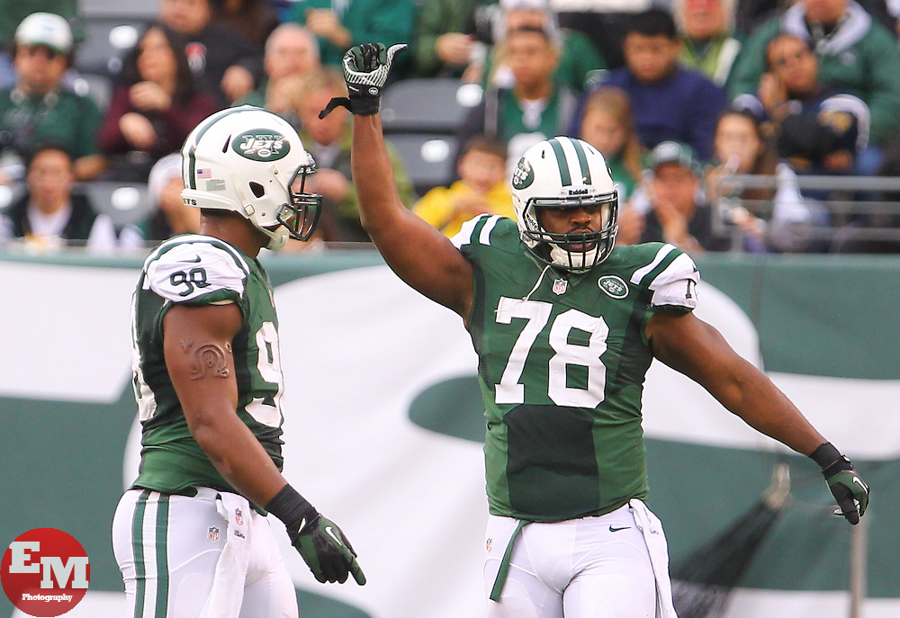 Dec 22, 2013; East Rutherford, NJ, USA; New York Jets defensive tackle Leger Douzable (78) celebrates his sack of Cleveland Browns quarterback Jason Campbell (17) (not shown) during the second half at MetLife Stadium.  The Jets defeated the Browns 24-13.
