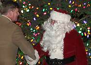 Hamptonburgh, New York  - Santa Claus shakes hands with Richard L. Rosé, commissioner of the Orange County Department of Parks, Recreation and Conservation after the tree lighting ceremony at Thomas Bull Memorial Park on Dec. 1, 2011.