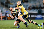 TJ Perenara puts in a big tackle during the Super Rugby match, Brumbies V Hurricanes, GIO Stadium, Canberra, Australia, 30th June 2018.Copyright photo: David Neilson / www.photosport.nz