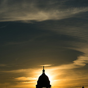 The rising sun lines up directly behind the dome of the US Capitol Building (Congress) in Washington DC.