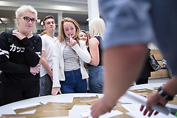 © Licensed to London News Pictures . 20/08/2015 . Salford , UK . Students at St Patrick's RC High School in Eccles collect their GCSE results . Photo credit : Joel Goodman/LNP