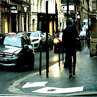 The photograph of a street with traffic and pedestrians in Paris in the mirror.
