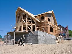 Timber framed house under construction in Yuzhno Sakhalinsk Sakhalin Island Russia 2008