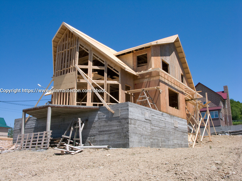 Timber framed house under construction in Yuzhno Sakhalinsk Sakhalin Island Russia 2008