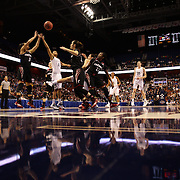 Moriah Jefferson, UConn, challenges for a rebound with Ana Owens, Cincinnati, during the UConn Vs Cincinnati Quarterfinal Basketball game at the American Women's College Basketball Championships 2015 at Mohegan Sun Arena, Uncasville, Connecticut, USA. 7th March 2015. Photo Tim Clayton