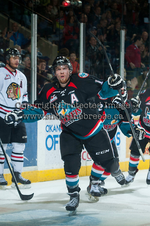 KELOWNA, CANADA - NOVEMBER 22: Rourke Chartier #14 of Kelowna Rockets celebrates the third goal of the third period against the Portland Winterhawks on November 22, 2014 at Prospera Place in Kelowna, British Columbia, Canada.  (Photo by Marissa Baecker/Shoot the Breeze)  *** Local Caption *** Rourke Chartier;