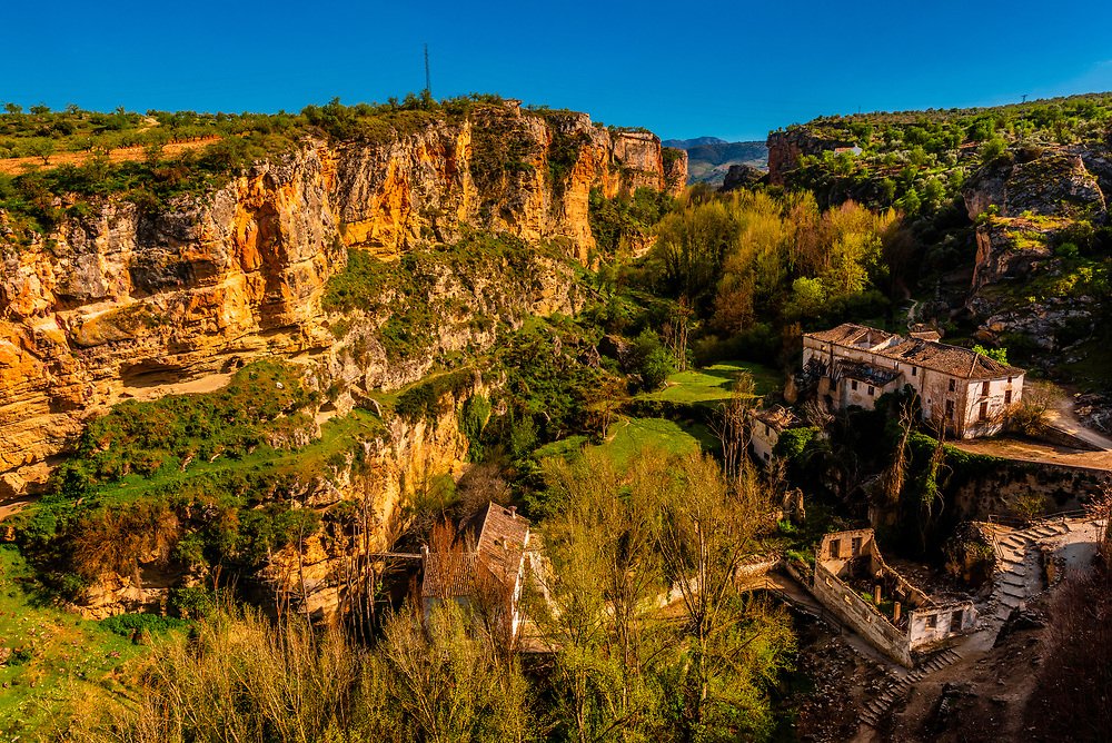 La Purisima, an old flour mill and a 16th century aqueduct and behind Los Tajos (the Gorge), Alhama de Granada,Granada Province, Andalusia, Spain.