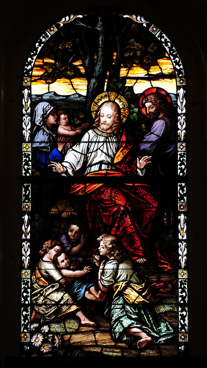 Stained glass image of Jesus sitting with children. From St. Francis Xavier Cathedral in Green Bay. (Photo by Sam Lucero)