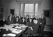 Meeting of the Council of State convened at Áras an Uachtaráin by President Eamon de Valera..(l-r front row) .Cathorlaigh Sheanad Eireann-Liam Ua O'Buachalla;.Tanaiste agus Aire Gnotha Eachtacta-Prionsias MacAogain;.An Taoiseach- Sean O Loinsigh;.An tUachtarain-Eamon de Valera;.Acting Clerk of the Council-M. O'Slataraigh;.An Priomh-Bhraitheamh-An Saoi Onorach Cearbhaill O'Dalaigh;.Uachtaran na hArd-Chuirte-An Braitheamh Onorach Aindrias O Caoimh;.(standing).Deputy Seán Lemass;.Dr. Robert Briscoe;.Deputy Brendan Corish;.Deputy James M. Dillon;.Mrs. Jane Dowdall;.Deputy Maurice E. Dockerall;.An Saoi Onorach Conchubhar Maguidhir;.An Ginearal Risteard Ua Maolchatha;.Deputy J.A. Costello;.An tArd-Aighna Colm Condun..06.03.1967